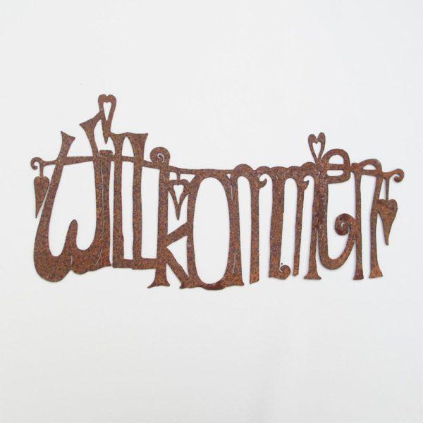 Schriftzug Willkommen aus gerostetem Metall by blueme & gschänk chäller